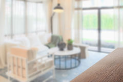 Wooden table top with blurred background interior living room. With decorative lamp royalty free stock photos