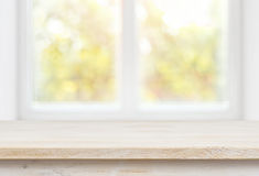 Wooden table top on blurred glass window wall building background Royalty Free Stock Image