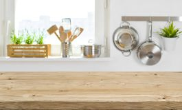 Wooden table top on blurred kitchen interior with copy space stock photos