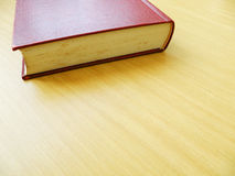 Wooden table top and book