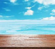 Wooden table top on bright blue sea Royalty Free Stock Image