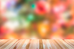 Wooden table top  with christmas blurred background. Stock Image