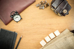 Wooden Table top with  clock,type box,notebook,leather bag and p Royalty Free Stock Photos