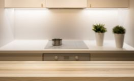 Wooden table top on kitchen island in modern simple home interior. stock photo