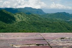 Wooden table top with the mountain landscape. Background stock photo