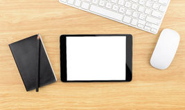 Wooden table top with tablet,black notebook,pencil,keyboard and Stock Photography