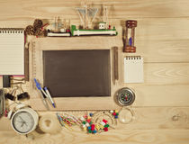 Wooden table top view of the chalk board with creative stationer Stock Photo