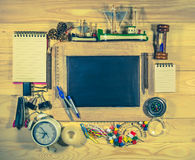 Wooden table top view of the chalk board with creative stationer Stock Photos