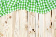 Wooden table, top view, green checkered tablecloth Royalty Free Stock Photo