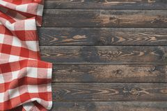 Wooden table top view with red picnic cloth stock photography