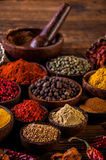 Wooden table of traditional Asian spices Stock Images
