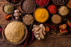 Wooden table of traditional Asian spices Royalty Free Stock Photos