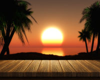 Wooden table and tropical sunset Royalty Free Stock Photos