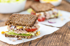 Wooden table with Tuna sandwich (on wholemeal bread; selective f Stock Images