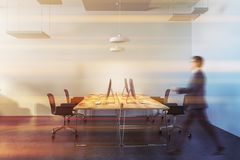 Wooden table white open space office interior, man Stock Image