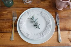 White plates on the wooden table royalty free stock photography