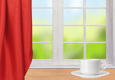 Wooden table, white window and white coffee cup. Wooden table, white window, red cloth and white coffee cup Stock Photos
