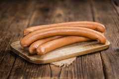Wooden table with Wiener Sausages selective focus. German Sausages Wiener as high detailed close-up shot on a vintage wooden table selective focus Stock Photography
