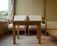 Wooden table by the window Royalty Free Stock Photos