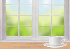 Wooden table, window and white coffee cup Royalty Free Stock Photo