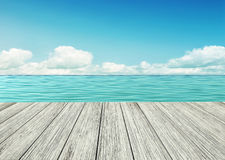 Wooden table,  wooden floor by the seashore Stock Image