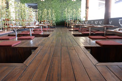 Wooden tables in Asian restaurant Royalty Free Stock Photo