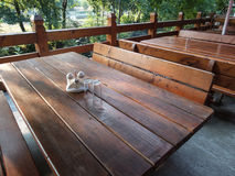 Wooden tables and bench on terrace Royalty Free Stock Photography
