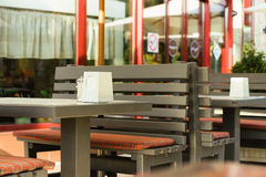 Wooden tables in a cafe outdoors in the summer Stock Photography