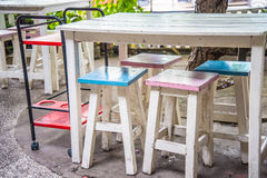 Wooden tables and chairs Stock Photography