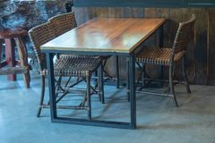 Wooden tables and chairs royalty free stock photography