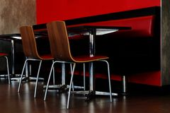 Tables and chairs in the room. stock images