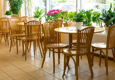 Wooden tables and chairs Stock Photos
