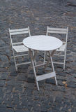 Wooden tables and chairs and stone blocks Royalty Free Stock Photos