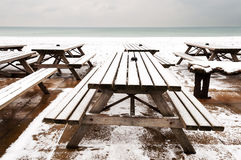 Wooden tables covered by snow Stock Image