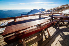 Wooden tables overlooking mountain valley Stock Image