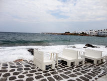 Wooden Tables almost in the sea, Paros Island, Greece Stock Photo