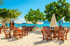Wooden tables with sun umbrellas at luxury resort Stock Photos