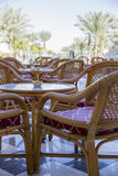 Wooden tables and wicker chairs from the vines on the marble flo Stock Photo