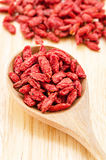 Wooden tablespoon of dried goji berries Stock Photos