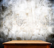 Wooden tabletop at crack concrete wall,Template mock up for display stock photography