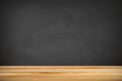Wooden tabletop and empty chalkboard for your text Royalty Free Stock Photography
