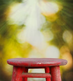Wooden tabletop with fresh nature bokeh background Royalty Free Stock Image