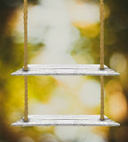 Wooden tabletop with fresh nature bokeh background Royalty Free Stock Photography