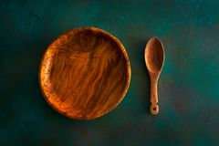 Wooden tableware on grungy green royalty free stock photos