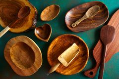 Wooden tableware on grungy green royalty free stock photo