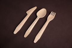 Wooden tableware. On the table Royalty Free Stock Images