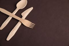 Wooden tableware. On the table Stock Photography
