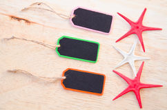 Wooden tag label on and star fish Stock Images