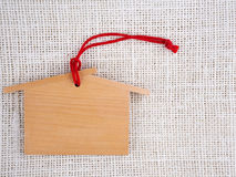 Wooden tag with string on hemp sack Royalty Free Stock Photo