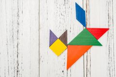 Wooden tangram in a cat shape Royalty Free Stock Image